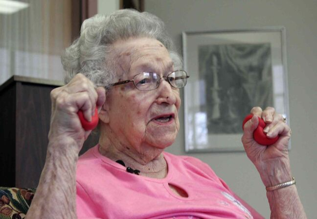 Hildegard Gigl leads a twice weekly exercise class at Hawthorne Terrace independent retirement center in Wauwatosa, Wis.