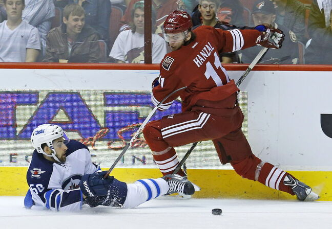 Winnipeg Jets center Eric O'Dell (58) collides with Phoenix Coyotes center Martin Hanzal (11) during the first period.
