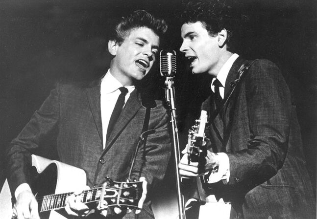 This July 31, 1964 file photo shows Don Everly and Phil Everly of The Everly Brothers during a performance. The Rock and Roll of Fame will honor the Everly Brothers with a tribute concert this fall. The Rock Hall announced Thursday that surviving member Don Everly will appear at the Oct. 25 event at PlayhouseSquare's State Theatre in Cleveland. Phil Everly died from chronic obstructive pulmonary disease earlier this year. The Everly Brothers were inducted into the Rock Hall in 1986 and the Country Music Hall of Fame in 2001. (AP Photo, File)