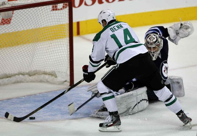 Winnipeg Jet goaltender Ondrej Pavelec is beaten by Jamie Benn of the Dallas Stars during the first period.