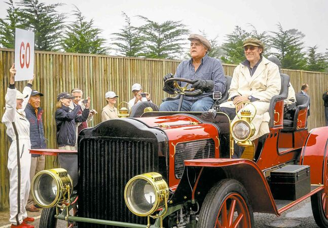Jay Leno (left) gets set for the start of the Pebble Beach (Calif.) Tour Thursday.