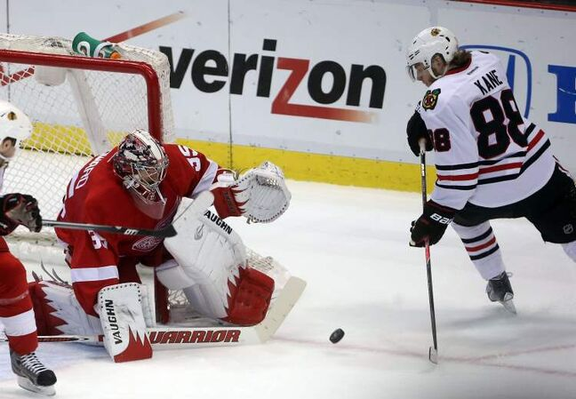 Detroit Red Wings goalie Jimmy Howard stops Chicago Blackhawks winger Patrick Kane during the first period.