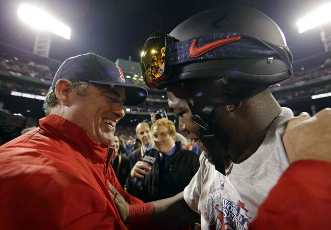 Boston Red Sox manager John Farrell and David Ortiz celebrate.