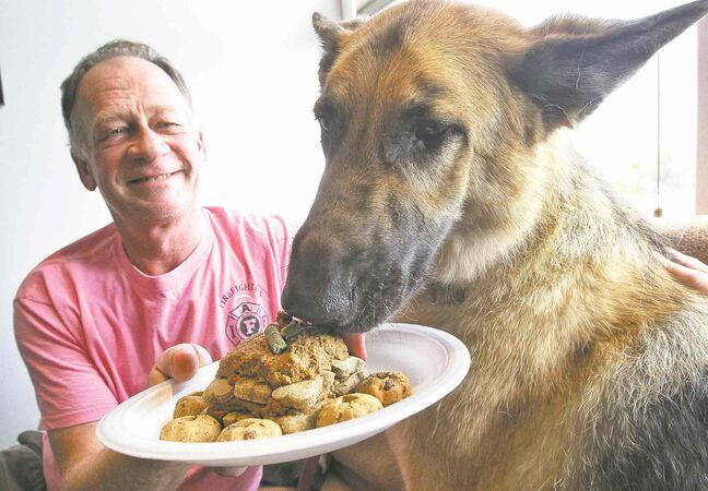 Marvin Loewen shares his treats with Freya at the Anderson Animal Hospital and Wellness Centre.