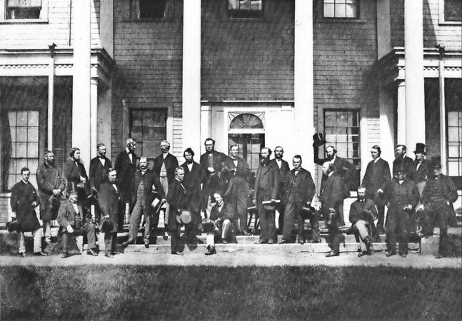 The Fathers of Confederation meet in Charlottetown in 1864. John A. Macdonald is seated, centre front.