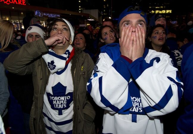 Toronto Maple Leafs fans react to the Boston Bruins overtime goal while watching from Maple Leafs Square in Toronto.