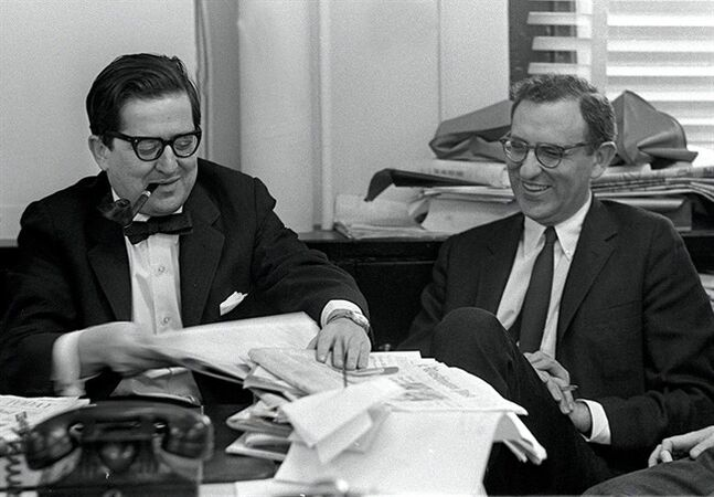 In this October 27, 1967 photo New York Times, New York Time's editors A.M. Rosenthal, left and Arthur Gelb, are seated at a desk in Rosenthal's office at the New York Times the year that Rosenthal was elevated to Executive Editor and Gelb succeeded him as Managing editor. Gelb, whose news sense, arts sensibility and journalistic vigor sculpted The New York Times for decades, died Tuesday, May 20, 2014 at age 90. (AP Photo/New York Times) MANDATORY CREDIT
