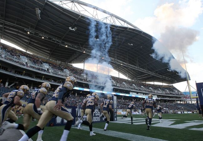 Winnipeg Blue Bombers head on to the field just prior to kickoff.
