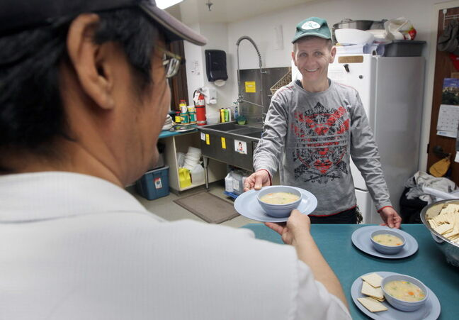Kelly Ross serves food to clients of the drop-in centre at Crossways in Common.