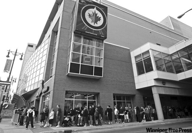 TREVOR HAGAN / WINNIPEG FREE PRESSMore then 100 fans line the street Saturday near Jets Gear, the official merchandise outlet for the Winnipeg Jets located inside the MTS Centre at the corner of Portage and Hargrave.