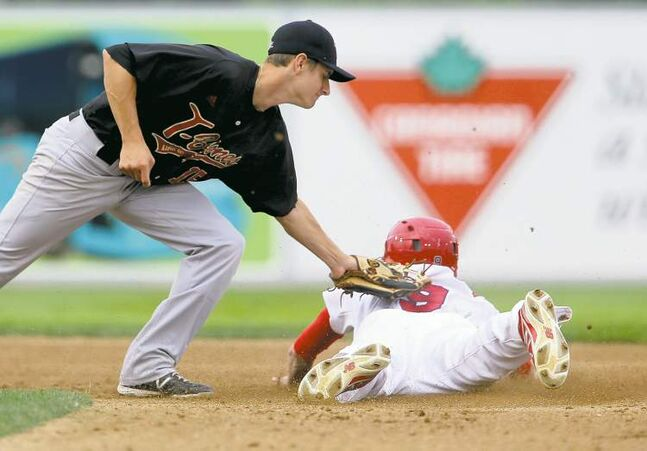 Winnipeg Goldeye Tyler Graham swipes second, diving under the glove of Kansas City T-Bones Anthony Davis on Saturday night at Shaw Park.