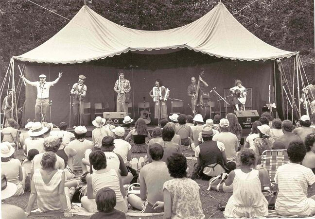 Performers entertain the crowd at one of the first Winnipeg Folk Festivals.