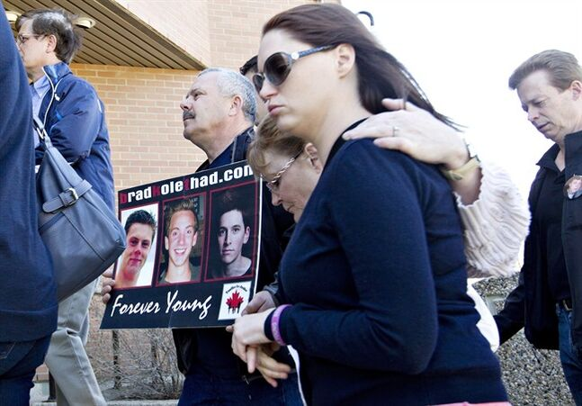 Family members of Bradley Arsenault, 18, Kole Novak, 18, and Thaddeus Lake, 22, make their way to the trial of Jonathan Pratt in Wetaskiwin, Alberta on Monday May 15, 2014. Thirty-year-old Jonathan Pratt has pleaded not guilty to manslaughter, impaired driving and driving over the legal limit relating to a 2011 crash. THE CANADIAN PRESS/Jason Franson