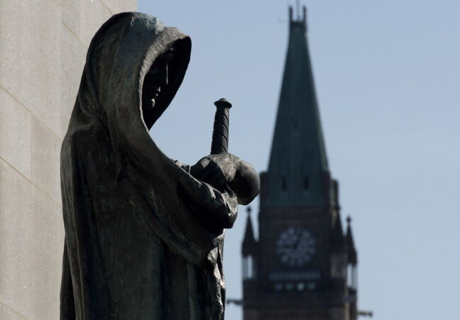 Veritas (Truth) guards the entrance of the Supreme Court as the Peace tower is seen in the background.