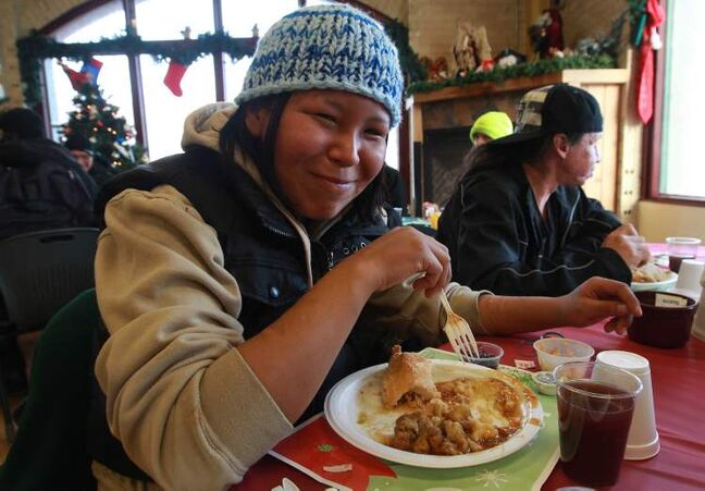 Wendy Nattaway from Garden Hill First Nation enjoys a warm meal at Siloam Mission.