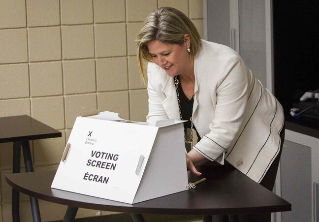 Ontario NDP Leader Andrea Horwath marks her ballot during an advanced poll at Big Brothers Big Sisters in Hamilton Saturday.
