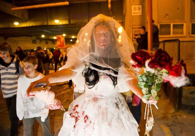 Zombie bride Michelle Daoust during the annual Winnipeg Zombie Walk from The Forks to The Manitoba Legislative Building Saturday night.  DAVID LIPNOWSKI / WINNIPEG FREE PRESS