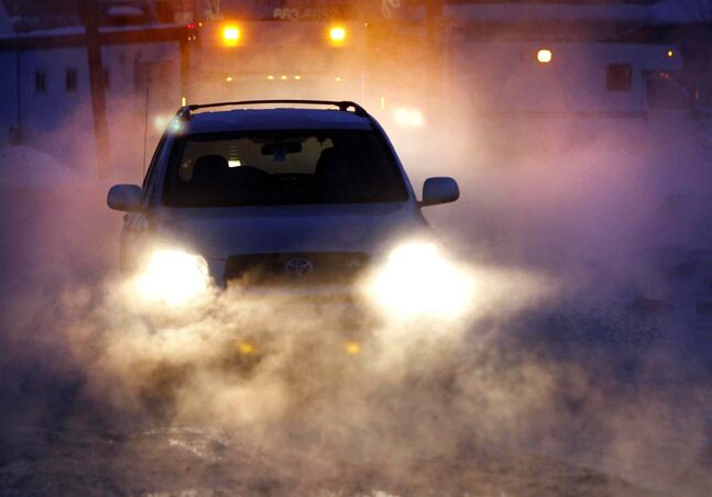 Motorists travel through steam from a water main break on Grey St. near Munroe Avenue on a -25 C Thursday morning.