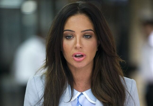 British singer Tulisa Contostavlos delivers a statement after her trial over drugs allegations collapsed, outside Southwark Crown Court, London, Monday, July 21, 2014. The drug trial of Contostavlos collapsed after the judge said an undercover reporter known as the