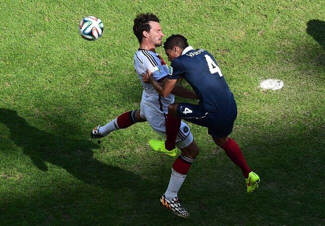 Germany's Mats Hummels, left, scores on a header during the World Cup quarterfinal soccer match between Germany and France at the Maracana Stadium in Rio de Janeiro, Brazil, Friday, July 4, 2014. (AP Photo/Francois Xavier Marit, pool)