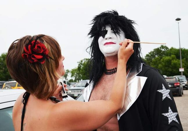 Erica Hillhorst does some last-minute touch ups on husband Cory's makeup before Wednesday night's Kiss concert in Brandon.