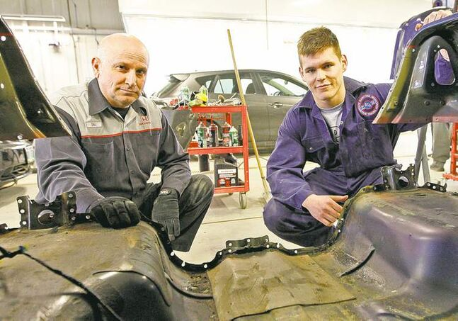 Maples Collegiate student Josh Pangman, right, with Sal Ardita, shop manager at Crown Honda autobody shop.