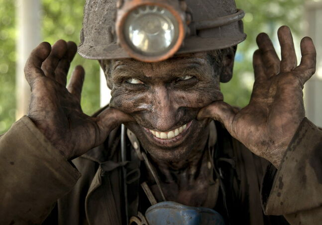 A Ukrainian coal miner smiles after finishing his shift at a coal mine outside Donetsk, Ukraine.A Ukrainian coal miner smiles, after finishing his shift at a coal mine outside Donetsk, Ukraine, Tuesday, May 20, 2014. While steel worker in Mariupol joined anti-separatist actions, miners refused to take part in a planned protest against the Donetsk People's Republic.