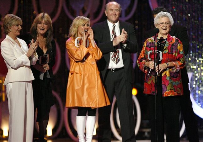 FILE - In this April 14, 2007, file photo, Florence Henderson, from left, Susan Olsen, Maureen McCormick, Lloyd Schwartz and Ann B. Davis of the television show