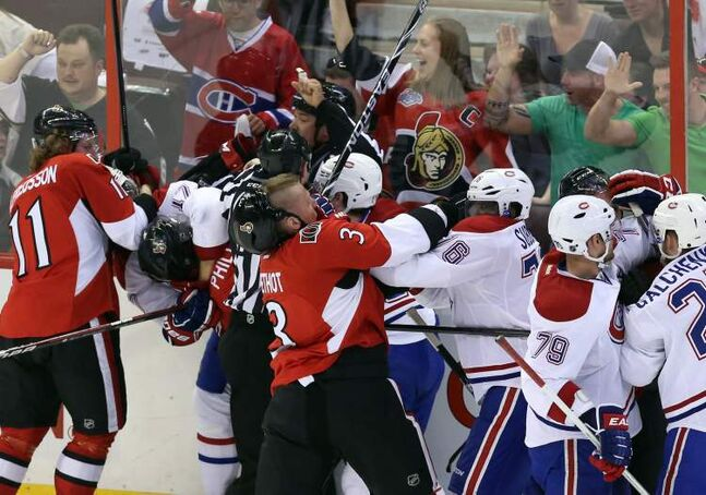 Fists fly as the Montreal Canadiens and the Ottawa Senators lose their cool during the third period of Ottawa's 6-1 romp at ScotiaBank Place on Sunday night. The Sens took a 2-1 series lead.