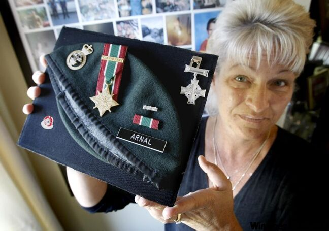 Wendy Hayward holds the war medals of her son, Canadian soldier  Cpl. James Arnal, who was killed by a roadside bomb on July 18, 2008  while serving his third tour of duty in Afghanistan.