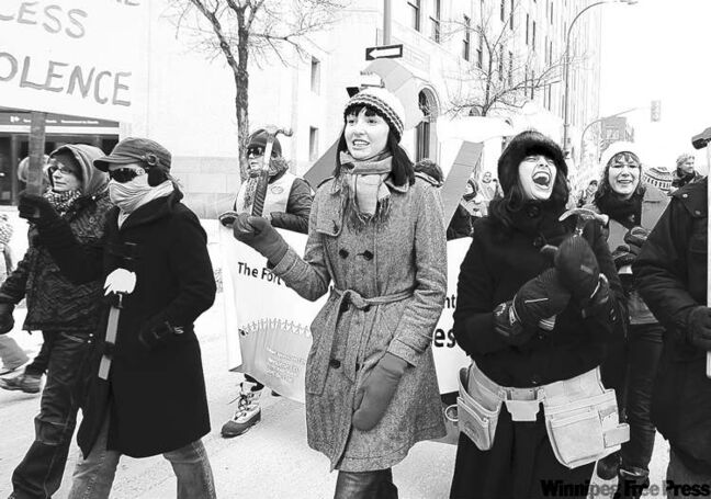Ruth Bonneville Winnipeg Free Press Local March 8/2009 - Members of local feminist group MS. Citizenship Collective Breanna Carels (left in Tweed) and Milena Tlacentile (black) passionately participate in local International Women's Day March down Main street Sunday afternoon.  See story.