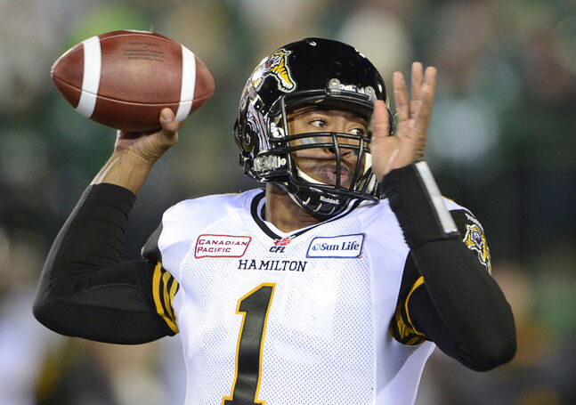 Hamilton Tiger-Cats quarterback Henry Burris fires a pass against the Saskatchewan Roughriders during the 2013 Grey Cup in Regina.