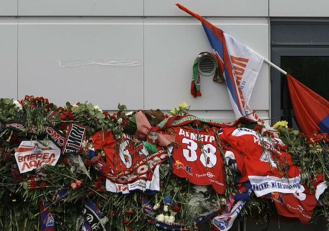 Thousands of flowers, team shirts, and flags are laid outside Arena Yaroslavl, the home rink of Lokomotiv Yaroslavl, on Thursday, Sept. 8, 2011.