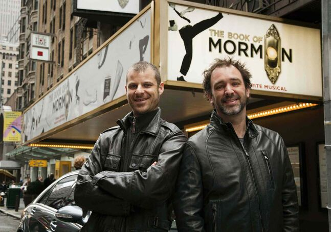 Trey Parker, right, and Matt Stone, co-creators of the Broadway show The Book of Mormon, pose for a portrait outside the Eugene O'Neill Theatre in New York in 2011. The smash Broadway musical from the creators of South Park is coming to Winnipeg in 2015.