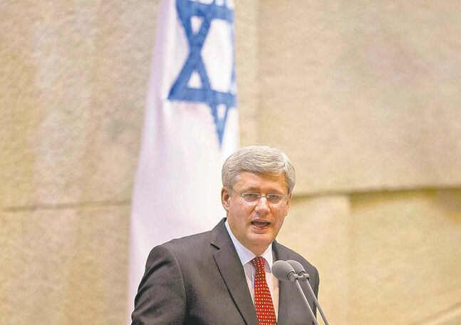 Prime Minister Stephen Harper speaks  at the Knesset in Jerusalem on Monday.