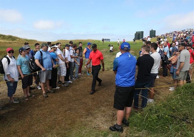 Tiger Woods of the US walks after playing his shot off the 17th tee during the final round of the British Open Golf championship at the Royal Liverpool golf club, Hoylake, England, Sunday July 20, 2014. (AP Photo/Jon Super)
