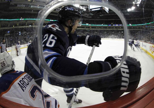 Winnipeg Jets' Blake Wheeler (26) hits Edmonton Oilers' Mark Arcobello (26) during the second period of Saturday's NHL game at MTS Centre.