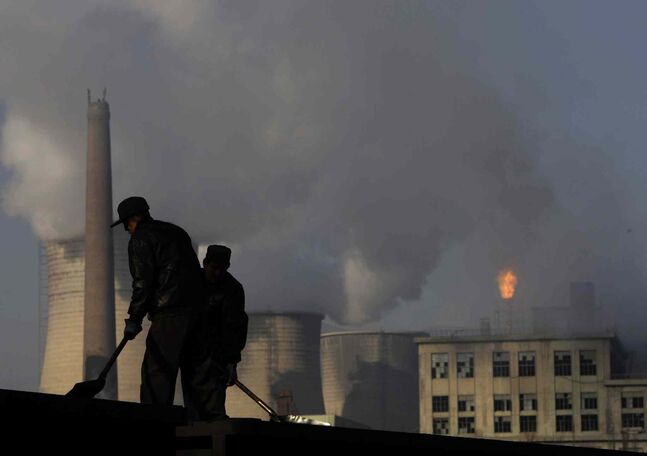 Miners shovel coal at a mine in Xiahuayuan county, north China's Hebei province. President Barack Obama's proposal to curb U.S. greenhouse gas emissions might improve the chances of completing a global climate treaty but is unlikely to defuse demands by China, India and others for Americans to do more.