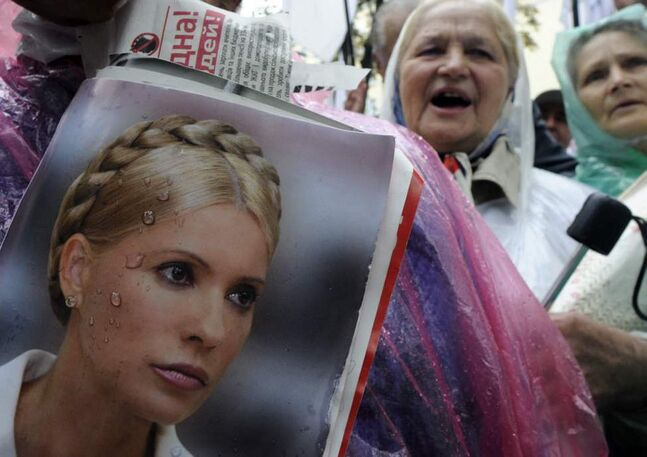 Supporters of former Ukrainian Prime Minister Yulia Tymoshenko take part in a rally outside Ukraine's High Specialized Court on Civil and Criminal Cases in Kyiv, Ukraine. (AP Photo/Sergei Chuzavkov)