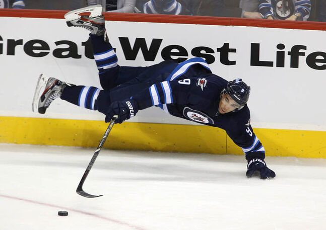 Winnipeg Jets' Evander Kane trips while handling the puck during overtime against the Florida Panthers at MTS Centre Tuesday night.