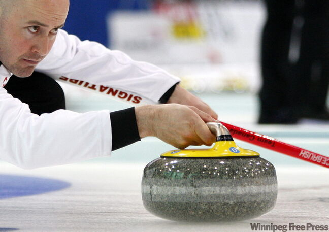Kevin Koe lines up a shot against Italy. The skip is 5-0 at the world championship.