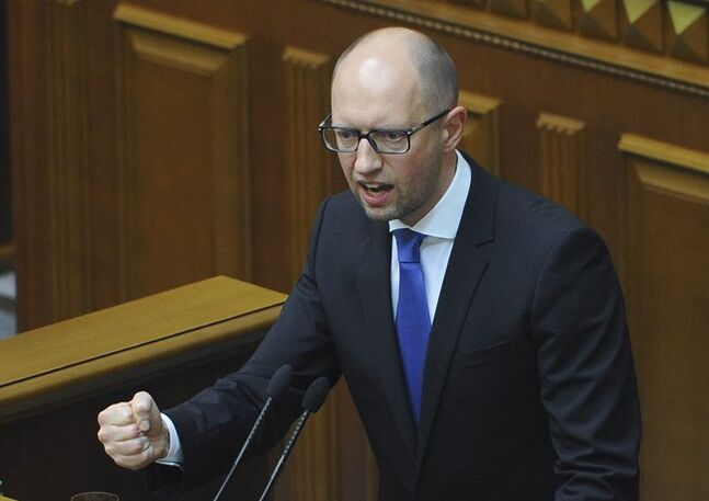 Ukrainian Prime Minister Arseniy Yatsenyuk speaks in the parliament in Kiev, Ukraine, Thursday, July 24, 2014. Arseniy Yatsenyuk announced his resignation Thursday, a move that opens the way for new elections that would reflect a the country's starkly changed political scene after the ouster of pro-Russian President Viktor Yanukovych in February. (AP Photo/Andrew Kravchenko, Pool)