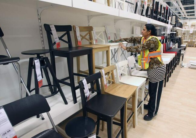 Cleaning staff work hard to make things perfect in the new Ikea.