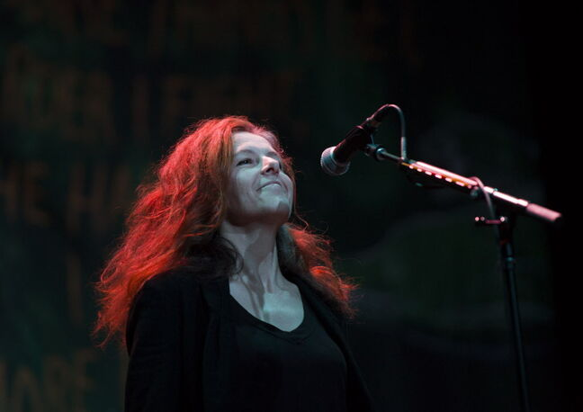 Neko Case performs with her band at the Burton Cummings Theatre Saturday night.