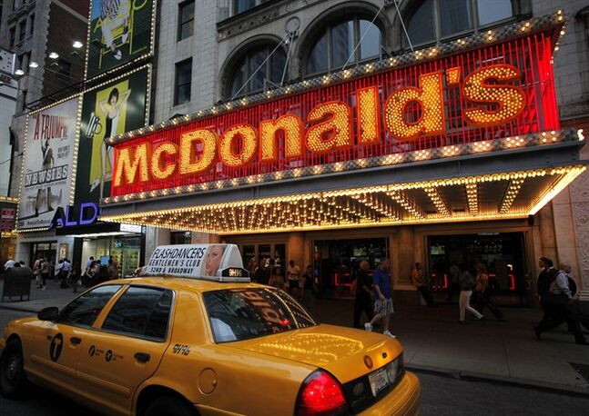 A taxi cab passes a McDonald's restaurant in New York's Times Square on July 11, 2013. THE CANADIAN PRESS/AP, Mark Lennihan