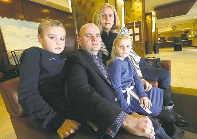 Karl and Petra Dornetschuber and their kids, Ben and Anna,  in the lobby of the Fairmont hotel, where they are staying after their Wellington Crescent home (below) burned  to the ground.