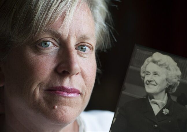 Michele Nadeau, president of the Therese Casgrain Foundation, holds a photo of her grandmother Therese Casgrain in Montreal, Friday, July 25, 2014.THE CANADIAN PRESS/Graham Hughes