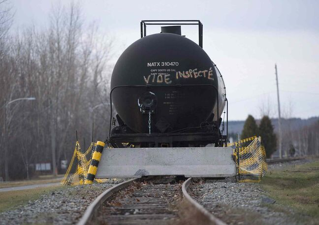 A railcar rests on a track in the town of Lac Megantic, Que., Thursday, November 21, 2013.  The CEO of Canadian Pacific Railway Ltd., Hunter Harrison, says the