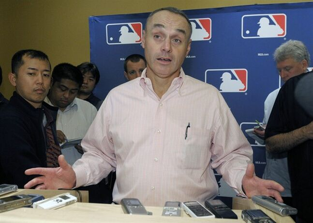 FILE - In this Nov. 16, 2010 file photo, Rob Manfred, Major League Baseball executive vice president for labor relations, talks to reporters during the meeting of baseball's general managers in Lake Buena Vista, Fla. Rob Manfred has been elected baseball's 10th commissioner, Thursday, Aug. 14, 2014 and will succeed Bud Selig in January. (AP Photo/Phelan M. Ebenhack, File)
