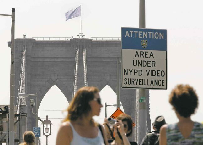 New York City police can't confirm the artists taking credit for the flags being switched are responsible.
